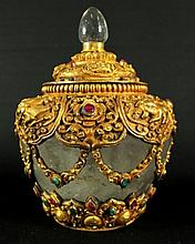A SOUTHEAST ASIAN ROCK CRYSTAL GILT BRONZE & JEWEL
