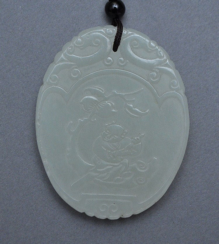 A Chinese Jade Oval Plaque