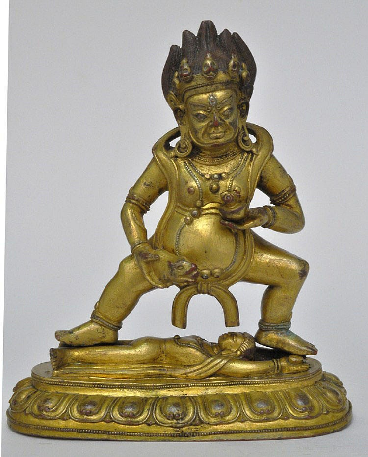 A Sino-Tibetan Gilt Bronze Jambhala (Wealth God), Qing