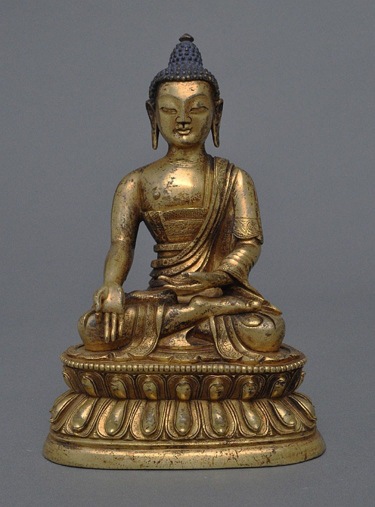 A Sino-Tibetan Gilt Bronze Buddha, 18th C. or earlier