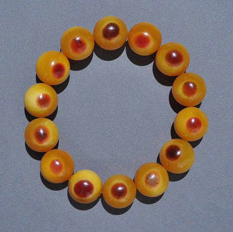 A Horn Beak Carved Bead Bracelet