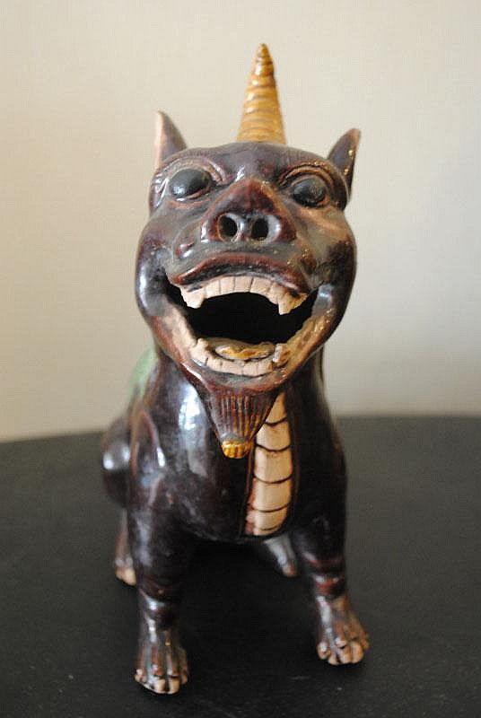 A Chinese Polychome Porcelain Unicorn