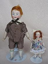 Two vintage All Bisque cabinet dolls:- 16cm wire