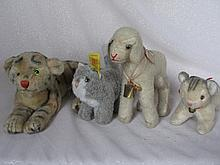 Five Steiff Animals:- lying 28cm Tiger, 15cm Lamby with hang tag no button, 10cm plush cat, shaved m
