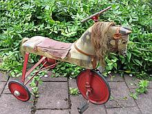 Rare 1930s Cyclops child Horse Trike. Wood carved horse on red steel frame and sold wheels, Cyclops