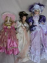 Three porcelain artist dolls:- 53cm all-porcelain in mauve ball gown. Franklin Mint 48cm in pink, El