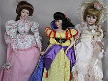 Three porcelain artist dolls:- 46cm Cinderella, 53cm Florence in cream walking out outfit. 53cm lady