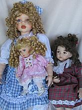 Three porcelain seated artist girl dolls:- LE Florence 66cm - reproduction 46cm Effner 'Molly' - com