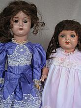 Two antique German dolls with wear:- metal head Minerva 58cm with brown s-eyes, replaced wig. Plaste