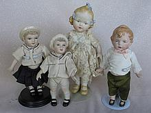 Four all-porcelain reproduction Artist Cabinet Dolls 15 - 19cm includes molded hats, bows, molded sh