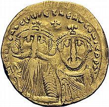 HÉRACLIUS et HÉRACLIUS CONSTANTIN (613-638). Solidus, Constantinople. A/. Bustes de face d'Héraclius avec longue barbe et de son fils. R/. Croix potencée sur trois degrés. Officine gamma. (Ratto, n°1369 - Sear, n°749). Or. 4,24g. (6h). B à TB. -