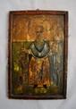 SAINT CHARALAMPE Le saint tient dans sa main droite le diable vaincu.  Bulgarie  début XIXe siècle Tempera sur bois, usures, restaurations et brûlures.  28 x 19 cm