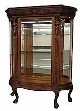 Barouque Carved Bow Front China Cabinet in the Manner of R. J. Horner, Oak with Carved Figural, Ancanthus and Foliated Designs, Mirr...