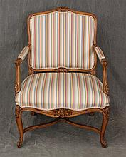 Louis XV Style Arm Chair, Walnut, Carved Arched Crest, Padded Open Arms, Carved Scrolled Apron on Cabriole Legs, 36 1/2