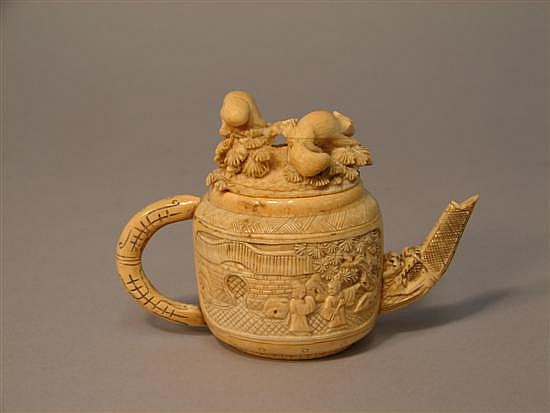 Carved ivory teapot, genre' carved body, quarduped carved finial, signed on base, H: 3in