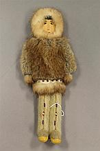 Alaskan Eskimo doll with seal fur and wooden face, 10