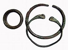 A pair of bronze bracelets and a thick bronze ring