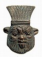 Detailed bronze face of Bes from Egypt