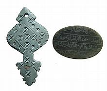 A pair of Islamic carved stone amulets