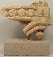 A fragment of stucco decorative relief