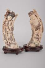 A pair of Chinese ivory figures.
