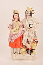 Antique Staffordshire figure of a