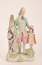 English Staffordshire figurine of a man and little girl.