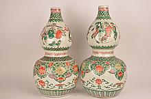 Large pair of Chinese porcelain double gourd vases, 19th century.