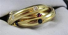 SIGNED CARTIER 18K TRINITY RING WITH DIAMOND, SAPPHIRE AND RUBY ACCENTS, SIZE 5 1/2, 10.8 GRAMS TOTAL