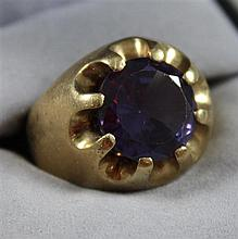 STAMPED 10 K YELLOW GOLD SYNETHETIC ALEXANDRITE RING, SIZE 8 1/2, 7.1 GRAMS TOTAL