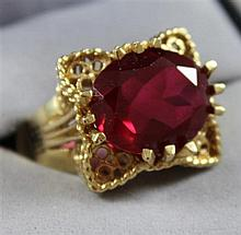 STAMPED 14K YELLOW GOLD FASHION RING WITH SYNTHETIC RUBY, SIZE 6 1/2, 7.8 GRAMS TOTAL