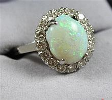 STAMPED 14K WHITE GOLD OPAL RING WITH SURROUNDING DIAMONDS, SIZE 7,  5 GRAMS TOTAL, SOME CHIPS ON OPAL