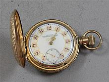 AMERICAN WALTHAM 14KYELLOW GOLD FILLED HUNTER CASE #6207529 POCKET WATCH WITH ORNATE DIAL, 55 MM DIAMETER, SLIGHT DENTS IN CASE