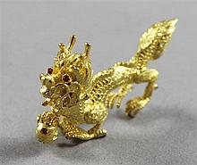 STAMPED ASIAN CHARACTER YELLOW GOLD DRAGON FIGURE, 1 3/4