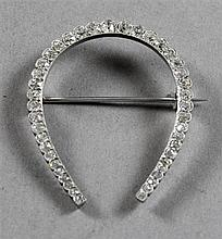 UNMARKED PLATINUM DIAMOND HORSESHOE BROOCH WITH APPROX