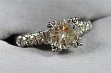 STAMPED PLATINUM APPROX. 1.42 CT ROUND BRILLIANT CENTER DIAMOND RING, SIZE 6, 5.5 GRAMS TOTAL, REPLACEMENT VALUE $16,400.00