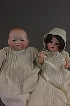 TWO BISQUE HEAD DOLLS. 11