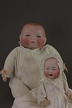 TWO BISQUE HEAD BABY DOLLS. 12 1/2