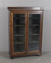 OAK BOOKCASE WITH GLASS DOORS AND ADJUSTABLE SHELVES, 39