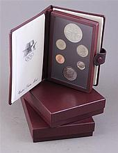 THREE 1984 LOS ANGELES OLYMPIC PRESTIGE COIN SETS INCLUDING SILVER DOLLARS