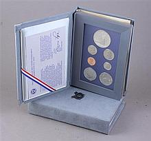 TWO US 1986 LIBERTY PRESTIAGE COIN SETS INCLUDING SILVER DOLLARS
