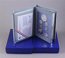 THREE US 1986 LIBERTY PRESTIAGE COIN SETS INCLUDING SILVER DOLLARS