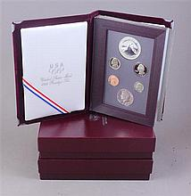 THREE US 1988 OLYMPIC PRESTIAGE COIN SETS WITH CLAD COINS