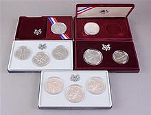 FIVE US OLYMPIC COIN SETS INCLUDING 1983, 1984 AND 1992 WITH SILVER AND CLAD COINS