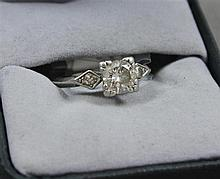 STAMPED PLATINUM APPROX .90 CT DIAMOND RING WITH TWO ACCENT DIAMONDS, SIZE 5 1/4, 4.8 GRAMS TOTAL, REPLACEMENT VALUE $6,850.00