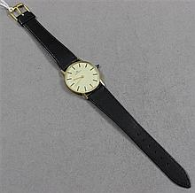 HALLMARKED YELLOW GOLD MOVADO MENS WATCH WITH LEATHER BAND, MOVEMENT 1 1/2