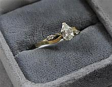 STAMPED 14K YELLOW GOLD APPROX .58 CT PEAR SHAPED DIAMOND WITH 4 ACCENT DIAMONDS, SIZE 9 1/4, 2.3 GRAMS TOTAL, REPLACEMENT VALUE $3,...