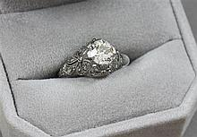 VINTAGE UNMARKED PLATINUM APPROX 1.20 CT CENTER DIAMOND AND 39 ACCENT DIAMONDS RING, SIZE 7 1/4, 4 GRAMS TOTAL, REPLACEMENT VALUE $1...