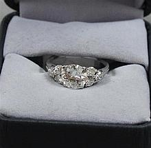 STAMPED PLATINUM APPROX 1.26 CT DIAMOND RING WITH 6 ACCENT DIAMONDS, SIZE 6 1/4,  3.6 GRAMS TOTAL, REPLACEMENT VALUE $13,965.00