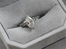 STAMPED PLATINUM APPROX 1.3 CT MARQUISE DIAMOND RING WITH BAGUETTE ACCENTS, SIZE 6 1/2, 4.1 GRAMS TOTAL, REPLACEMENT VALUE $9,875.00